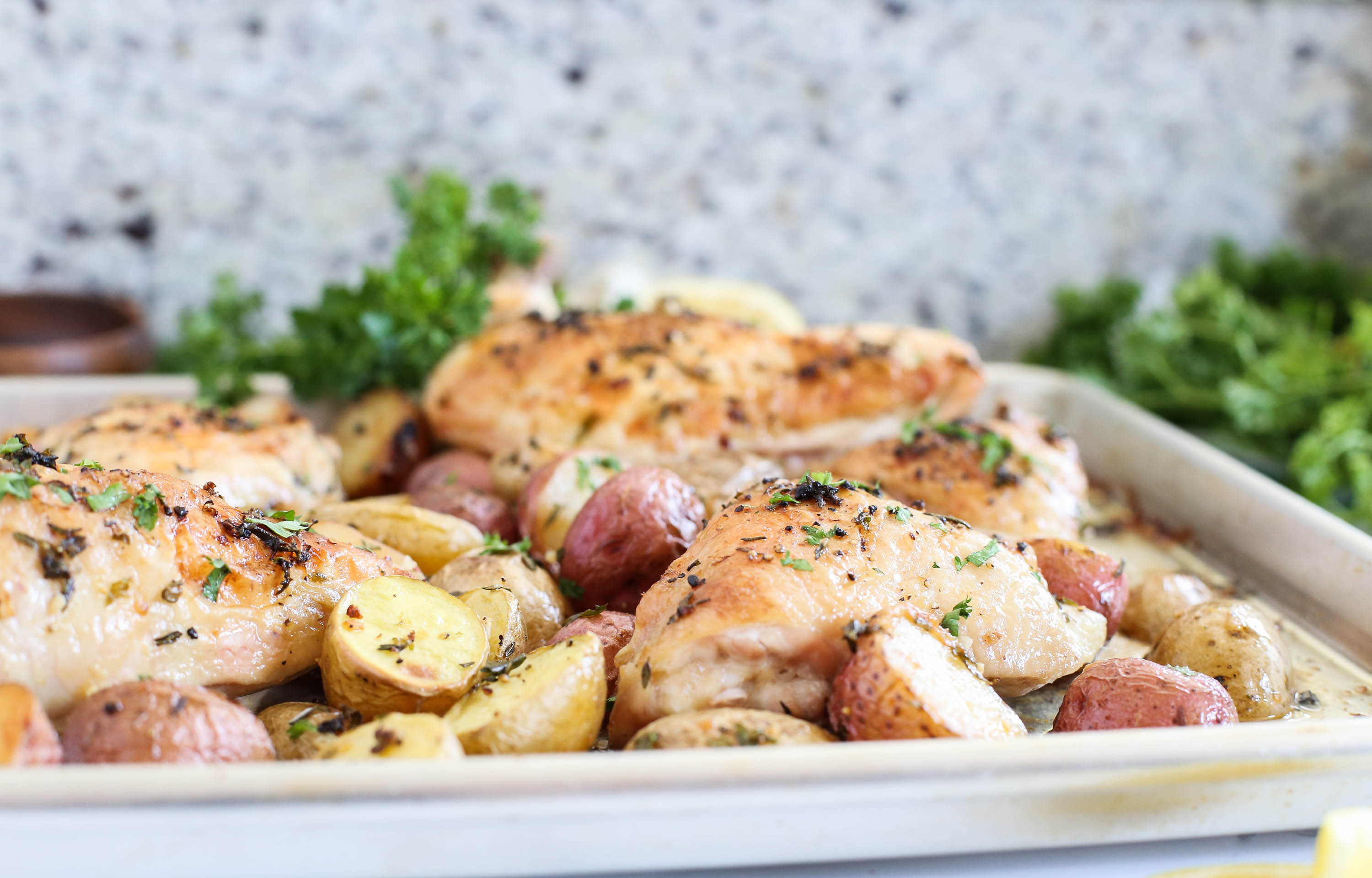Herb-Roasted Chicken with Potatoes via The District Table